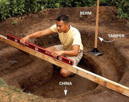 <b>Photo 1: Dig and level</b><br/>Dig the pond hole. To form a level rim, scrape away soil on the high side and build a bank on the low side. Compact built-up soil with a tamper.