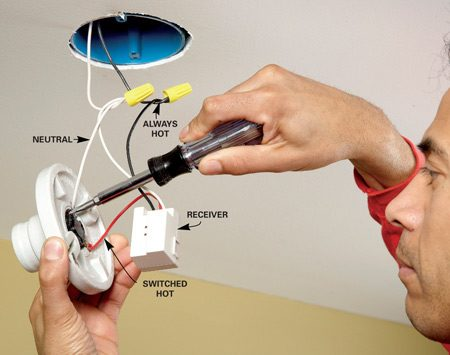 <b>Photo 1: Install the receiver</b></br> Disconnect the black and white wires from the porcelain fixture (power off). Connect them to the receiver/relay black and white wires. Then connect the red and white wires from the relay to the fixture.