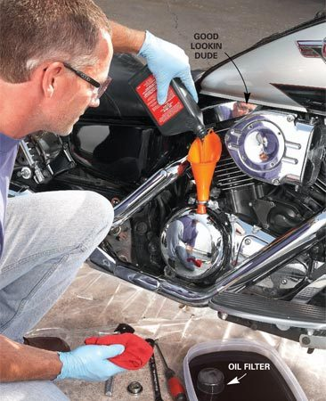 <b>Change engine oil</b></br> <p>Combustion gases  collect in your oil and form acid. You don't want that acid sitting in your  crankcase all winter eating away at bearings and other expensive parts. So even  if you've recently changed it, you need to change it again for winter storage.  Yes, it's that important.</p> <p>Bikes have low clearance and car drain pans won't fit.  So get a low-profile plastic food storage container (no, not from the kitchen)  and use that as a drain pan. Spin on a new filter and refill the crankcase with  fresh oil. </p>