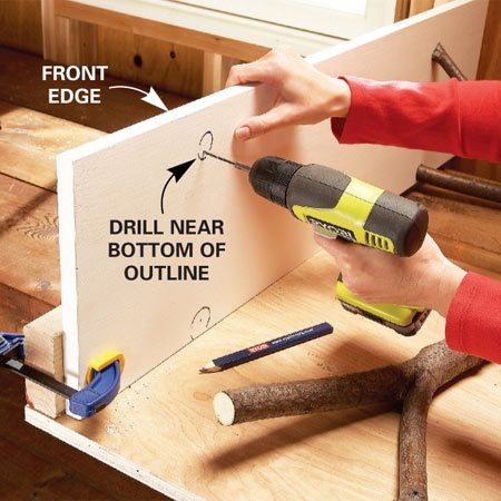 <b>Photo 2: Drill shelf holes</b></br> Trace around the branches where they touch the shelf bottom, then drill the holes and screw the shelf to the branches.