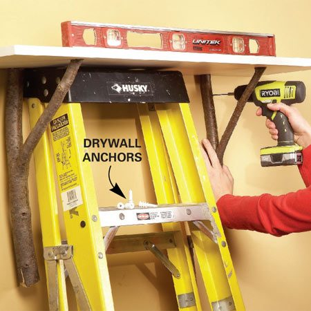<b>Photo 3: Fasten to the wall</b></br> Drill pilot holes near the top and bottom of the branch into the drywall. Then sink drywall anchors and screw the shelf to the wall.