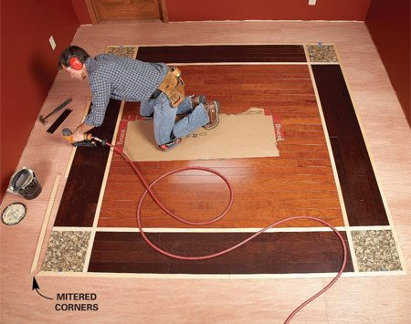 """<b>Photo 9: Place the outer accent pieces</b></br> Install the outer accent strips, mitering the corners. Install them so the groove """"catches"""" the tongue of the last full-width border flooring board."""