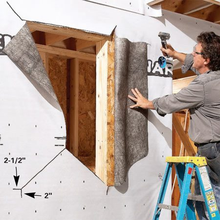 <b>Photo 2: Cut the house wrap </b></br> Slit the house wrap with a utility knife, then fold back and tack the side and top flaps out of the way.