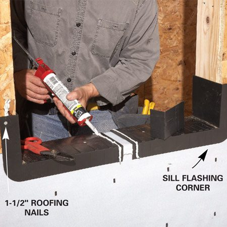 <b>Photo 3: Nail the sill flashing</b></br> Nail the corner sections of the sill pan with 1-1/2-in. roofing nails. Cut the center section of the sill pan to fit. Run a bead of sealant 1/2 in. from the lap joint. Then nail on the center section and spot the nail heads with caulk.
