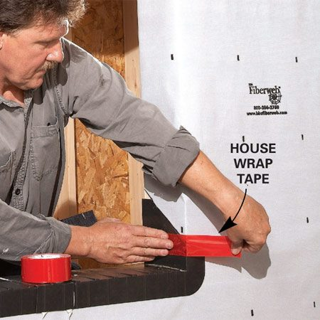 <b>Photo 4: Seal the housewrap</b></br> Fold the house wrap around the sides and staple them to the wall inside the room. Seal the house wrap against the pan with house wrap tape.