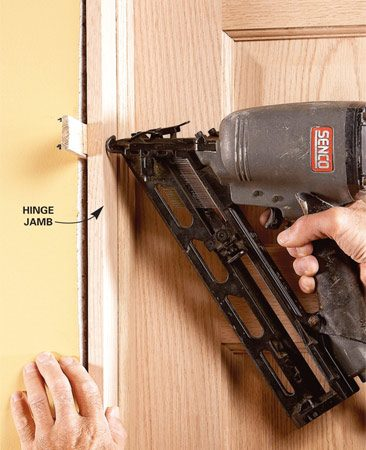<b>Nail door jamb at shims</b></br> Now you can simply set the door in the opening and nail through the hinge-side jamb into the shims. No more fumbling around trying to hold the door in place while you shim it. You'll still have to shim and nail the latch side, but that's easy with the door already supported.