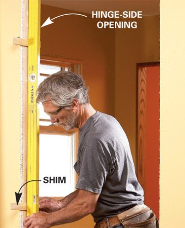 <b>Tack shims first</b></br> <p>Simplify  door installations by   shimming  the hinge side of the   rough  opening before you set the   prehung  door. Mark the hinge locations   first,  right behind the hinges   if you're  adding long screws into   the  framing for heavy solid-core   doors, or  just above or below the   hinges  for lightweight hollowcores.   Use a  long level or tape a   shorter  level to a 6-ft.-long straight   board.  Make sure the shims extend   equally  from both sides so the   jamb  won't get twisted. Shim the   top and  bottom first until the level   reads  plumb. Then use the level as   a  straightedge to set the center   shims.  Tack the shims into place with   your brad  gun. Aim for about a   1/4-in.  gap between the level and   the stud. </p>