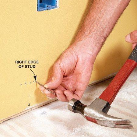 <b>Locate both edges of stud</b></br> When you're nailing baseboard, you can avoid finding and marking every stud. The key is to find the exact center of a stud that's on a 16-in. (or 24-in.) layout. Do this by looking for drywall screws along the bottom of the wall or probing the area on either side of and below an outlet. Make a series of nail holes into the wall where it will be covered with the baseboard, stopping when you find both edges of the stud.