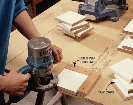 "<b>Photo 7: Rout the hub edges</b></br> <p>Cut the hubs to  length, then rout the edges using a ""corral""   tacked to your  workbench to safely hold the small pieces in   place. </p>"