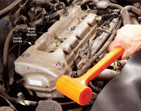 <b>Photo 1: Tap the cover loose</b></br> Remove the bolts and tap around the valve cover with a soft-faced mallet to break it loose. Never pry with metal tools—they can gouge the aluminum cylinder head and cause permanent leaks.
