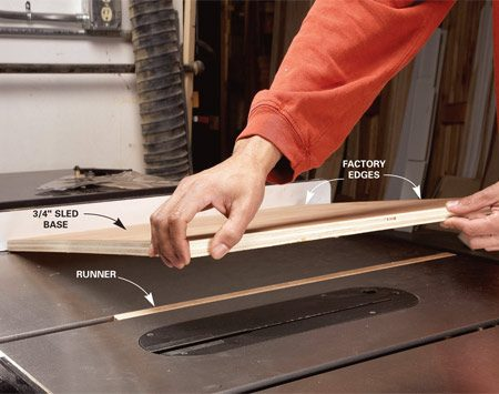 <b>Photo 2: Position the plywood</b></br> Lower the plywood onto the runner. Be sure to keep the plywood even with the saw table edge and tight against the fence as you lower it into place. If there are any gaps at the fence, your new sled won't give you square cuts