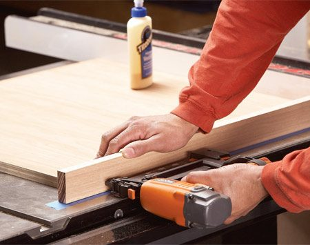 <b>Photo 4: Add the fence</b></br> Glue and nail the fence to the edge of the plywood. Keep the right edge even with the plywood and don't worry about the left side.
