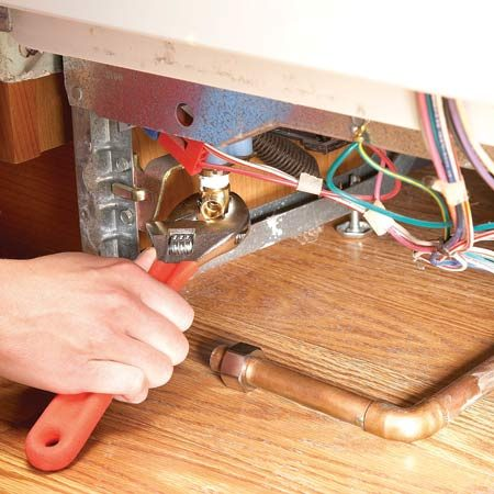 <b>Installing the elbow</b></br> Save the old water hookup elbow and reuse it on the new dishwasher.