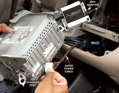 <b>Photo 1: Plug in the adapter</b></br> Plug the MP3 adapter into the external CD changer port on your factory radio. Use zip ties to secure the adapter to a recess behind the radio.