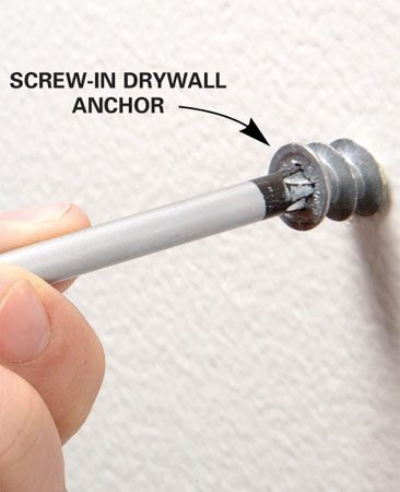 <b>Photo 2: Install drywall anchors</b></br> Screw your anchors into each marked spot and then attach the boards.