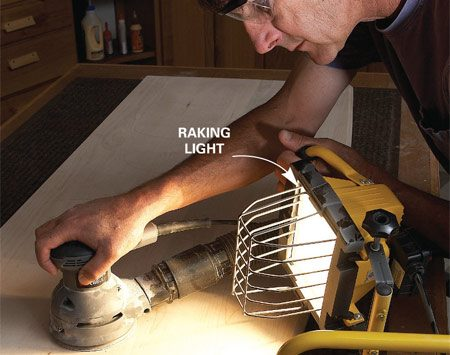 <b>Spotting flaws</b></br> Use a light held at a low, raking angle to check for scratches, dirt and any other imperfections while you sand and apply finish coats.