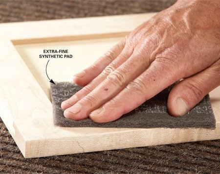 <b>Sand lightly between coats</b></br> Wipe off dust whiskers with extra-fine sanding pads. For larger blemishes, use 280-grit paper. The raking light will show you when the surface is smooth.