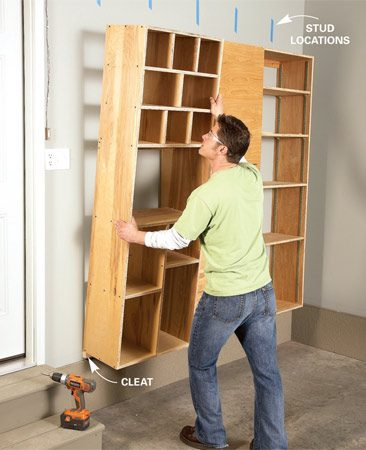 <b>Photo 3: Cleats support cabinets</b></br> Set the cabinets on a cleat, then screw them to the wall at the studs (use tape to mark the stud locations). Drive screws through the cabinet bottoms into the cleat.
