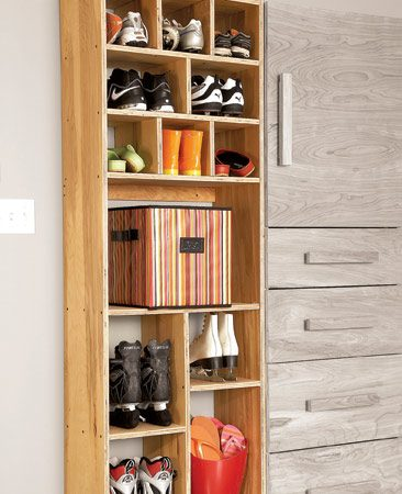 <b>Eliminate the footwear pileup on the back steps</b></br> The lower shelves in this cabinet hold boots and shoes, while the cubbyholes at the top are for slippers and sandals. The screw strip is lower in this cabinet than it is in the rest, but it'll still hold the cabinet in place.