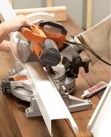 <b>Easy way to cut vinyl gutters</b></br> Cut vinyl gutter sections to length with a miter saw. You can use a handsaw, but you'll need to mark the cut carefully to get it square.