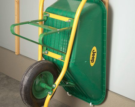 <b>Hang the wheelbarrow </b></br> Free up more floor space by hanging the wheelbarrow on the wall instead of leaving it on the floor.