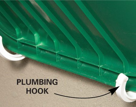 <b>Handy hooks</b></br> Versatile (and cheap) plumbing hooks catch the wheelbarrow lip.