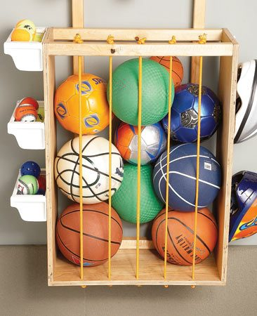 <b>Sports stuff storage</b></br> Instead of kicking balls around the garage to get them out of the way, toss them into this soft-sided storage bin.