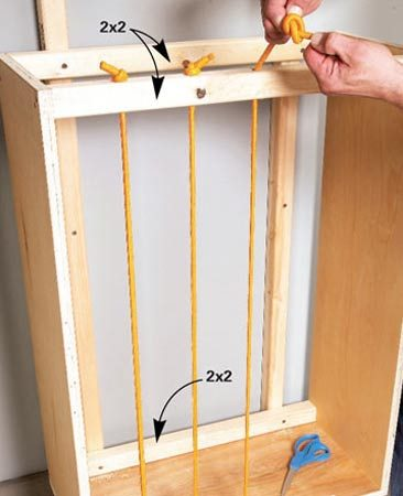 <b>Bungee cord slats</b></br> Cut the hooks off and knot the ends of the cords after threading them through the holes.