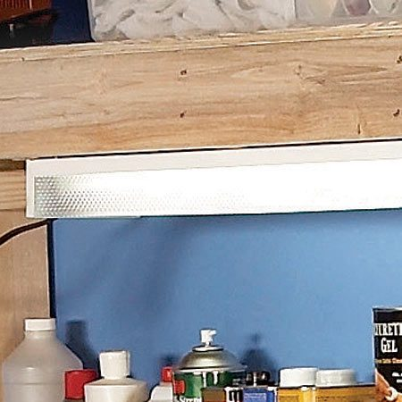 <b>Lighting</b></br> Good light is mandatory for any workbench. Buy an inexpensive 4-ft. shop light and screw it right to the underside of the top shelf.
