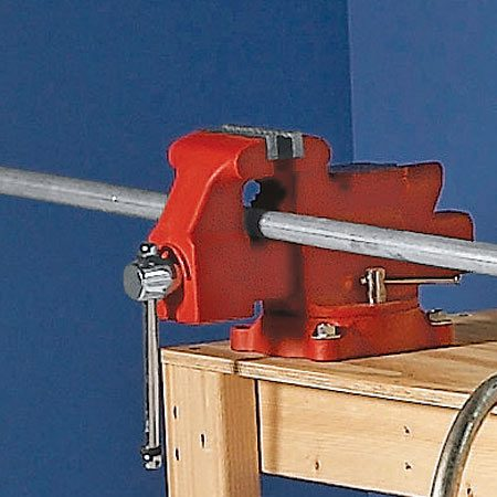 <b>Bench vise</b></br> Yes, it'll cost as much as or more than the bench, but what workbench would be complete without one?