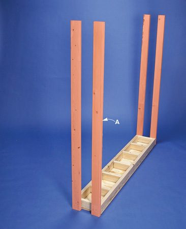 <b>Photo 7: Top shelf legs</b></br> Attach the top shelf legs upside down.