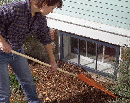 <b>Keep mulch and soil away from foundations</b></br> Rake moisture-wicking soil and mulch away from the window frames and low wood. Turn your mulch periodically to help keep dampness down, and keep bushes trimmed back as well.