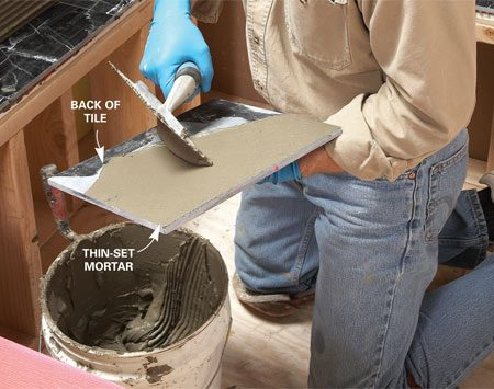 <b>Keep big tiles from coming loose</b></br> As bigger tiles have become more common, so has the problem of loose tiles in a finished tile job. It's harder to get a good bond with a large surface. Big tiles require a special technique: You need to trowel a thin layer of thinset on the back of each tile before you set it. Set the loaded trowel near the center of the tile and spread a thin layer of thin-set to the edge. Then rotate the tile a quarter turn and repeat until the back is evenly covered.
