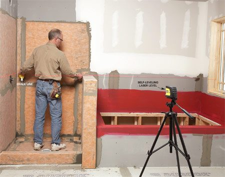 <b>Prevent mistakes with a laser level</b></br> Laser levels save time and increase accuracy. Dean uses a self-leveling laser to help plan the tile layout. He projects a level line around the room and measures from it to determine the size of the cut tiles along the edges. Then, after figuring out an ideal layout,  he uses the laser as a guide to chalk layout lines. The laser saves time by eliminating the fussy job of extending level lines around the room with a 4-ft. level.