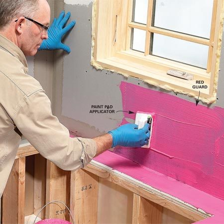 """<b>Apply a waterproof coating</b></br> The only sure way to keep water from reaching the backer board is to waterproof all areas that may be exposed to water. That's easy with the new waterproofing coatings. Dean uses the RedGuard brand, but there are others. Dean says, """"If in doubt, coat it with waterproofing."""" Follow the application instructions on the container. Dean applies the RedGuard with an inexpensive paint pad, which he prefers to a brush or roller because it works like a trowel, allowing him to quickly spread a thick, even layer."""