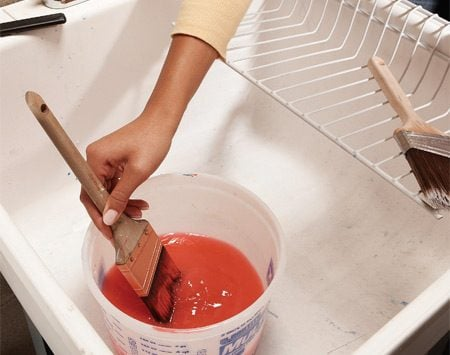 <b>Wash out most of the paint first</b></br> To ensure you get a lifetime of use out of your synthetic paintbrushes, clean each one immediately after using it, before the paint has a chance to dry. Wipe the brush on newspaper to remove excess paint. Then stick the brush into a bucket of warm water and move it around to remove as much paint as possible.