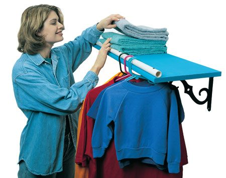 <b>Laundry shelf does double duty</b></br> Sometimes you just need another place to hang clothes, like on the shelf over your washer and dryer. Turn the edge of that shelf into a hanger rack by predrilling some 3/4-in. plastic pipe and screwing it to the edge of the shelf.