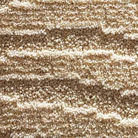 <b>Sculptured</b></br> Sculptured, or cut-and-loop, made with looped and non-looped tufts, is economical and durable. The varied shading hides dirt well, but the seams can be more visible. Prices start at about $6 per sq. yd. for 26- to 30-oz. face weight. Price and durability increase with higher face-weight yarns.