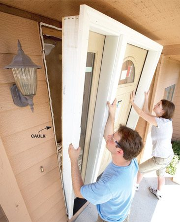 <b>Photo 7: Set the door frame</b></br> Robin and Danny could rest easy now. The door frame slid into the opening as planned and the heavy-lifting part of the job was done.