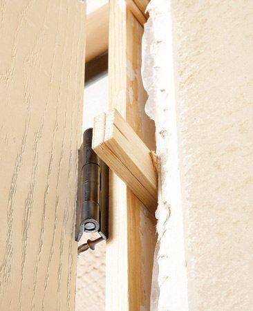 <b>Photo 10A: Close-up of shims</b></br> Use pairs of shims to bridge gaps.