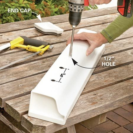 <b>Photo 1: Drill drain holes</b></br> Cut a 2-ft. length of vinyl gutter and glue one of the end caps into place with kitchen and bath adhesive caulk. Drill 1/2-in. drainage holes every 4 in. along the bottom of the gutter.