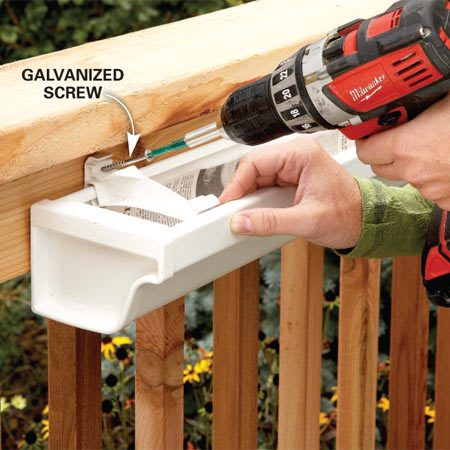 <b>Photo 3: Mount on the railing</b></br> Screw the planter to the deck rail through the fascia support brackets using galvanized screws.