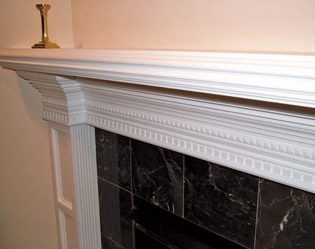 Marble and wood mantel and surround