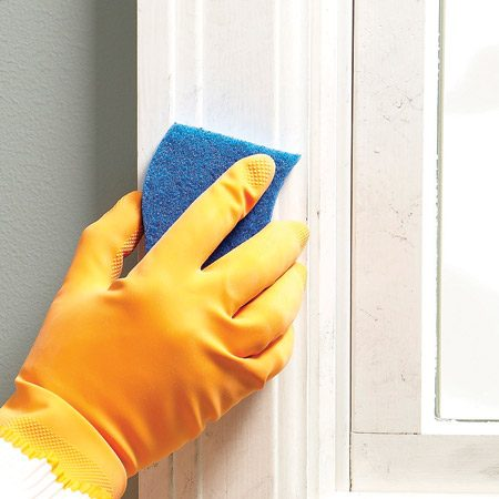 <b>Clean surfaces with TSP</b></br> Sponge walls and trim with a TSP solution to clean off dirt, oils and grease and prep the surface for better paint adhesion.