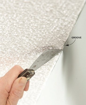 <b>Groove textured ceiling edges</b></br> Cutting a slight groove along textured ceilings leaves a smooth edge for your paintbrush to follow.