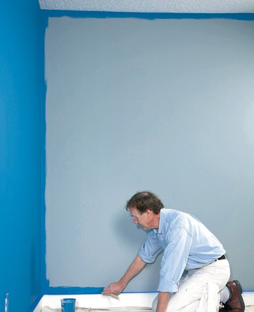 <b>Cut one wall at a time</b></br> Damp paint from cutting in will blend with the paint from the roller.