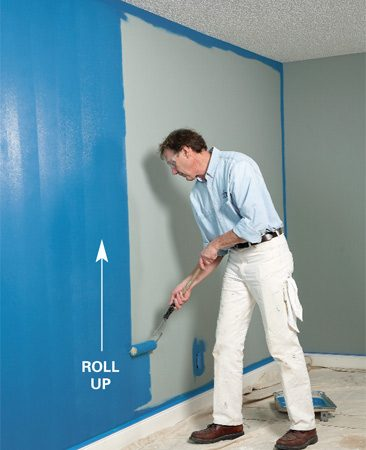 <b>Photo 2: Roll straight up</b></br> Unload the roller moving it up the wall.