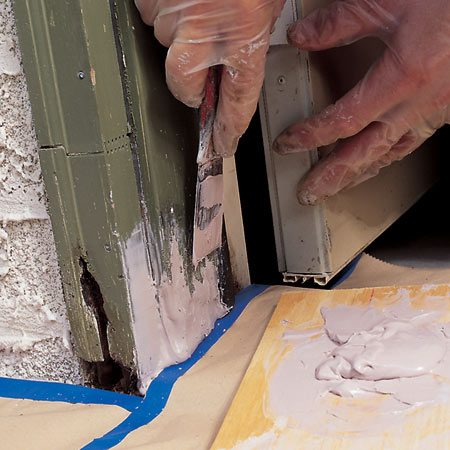 <b>Photo 2: Shape and smooth</b></br> Carve the partially hardened sagging wood filler with a putty knife or chisel. Add another layer of filler if necessary.