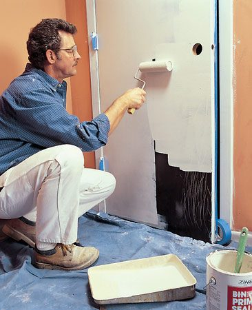 <b>Priming a door</b></br> For quicker priming, use a roller on the door and a 2-in. brush on interior trim such as casings, base and doorjambs. For a smooth paint job, sand lightly after the primer dries.