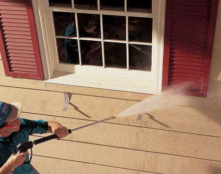 <b>Pressure-washing painted siding</b></br> Pressure washing removes loose paint and built-up grime and improves paint adhesion. Keep the nozzle at least 16 in. away from the wood.
